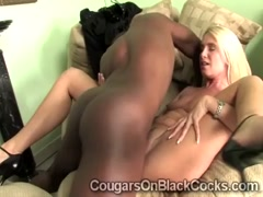Mature blonde hottie enjoys a massive black schlong