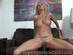Busty blonde cougar Brooke mounts a huge piece of chocolate