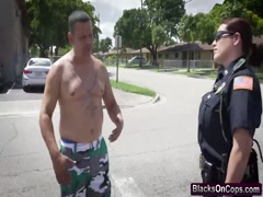 Muscled black dude fucks two slutty female cops by their car
