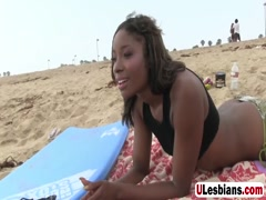 Gorgeous ebony dykes lick one another
