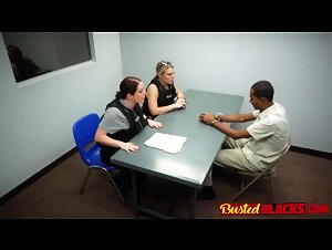 Black raider rides police females on interrogation desk