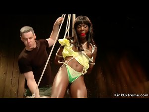 Ebony slave is tied and strapped