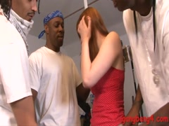 Skanky redhead hottie double fucked by big black cocks