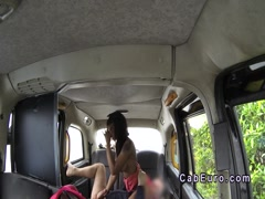 Inked ebony gives interracial rimjob in fake cab