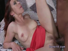 Natural busty redhead gets big black cock till creampie