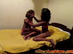 Ebony lesbians masturbate together while being filmed