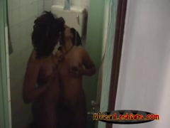 Two horny booty African lesbians havng fun under the shower