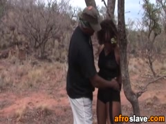 African babe gets her slave going on outdoors