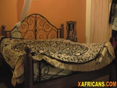 African chick bouncing on white schlong in bedroom