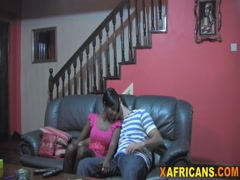 Homemade interracial fuck in front of TV
