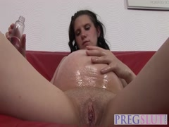 Pregnant slut bouncing on long black schlong