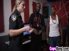 Naughty cops sucking arrested guy black boner