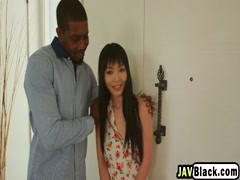 Smiley giggly Asian Chick impressed with a huge black cock