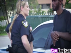 Busty cops riding black guy by the police car