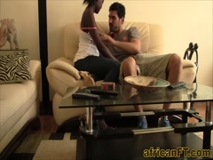 African babe enjoys bouncing on long white rod