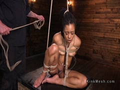 Brunetal bondage and cane for ebony slave