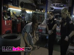 Black mechanic gets abused by busty cops in garage