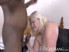 Blonde granny blowing black dick