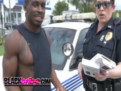 Police MILF duo riding a black convict dick instead of work