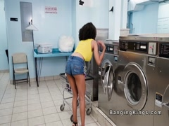 Slim college ebony bangs in laundromat