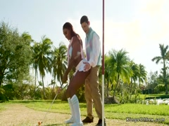 Ebony flashes huge tits at golf court