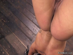 Ebony in bondage suffers zipper