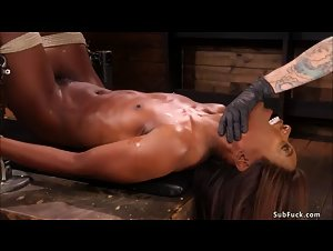 Ebony slave is anal plugged and banged